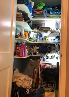 Linen closet before image
